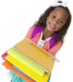 child holding school supplies